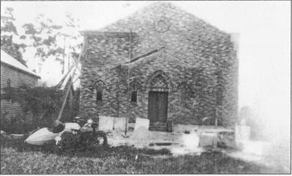 Building of St Patrick's Church in progress 1936 with original Church to the left.